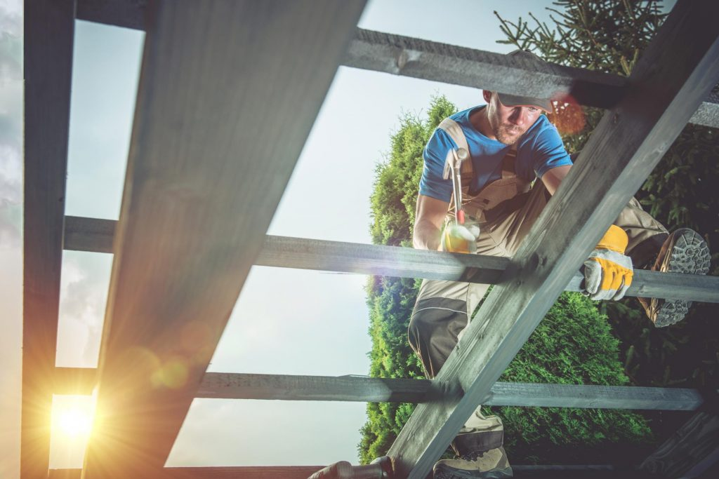 professional roofer doing roof installation