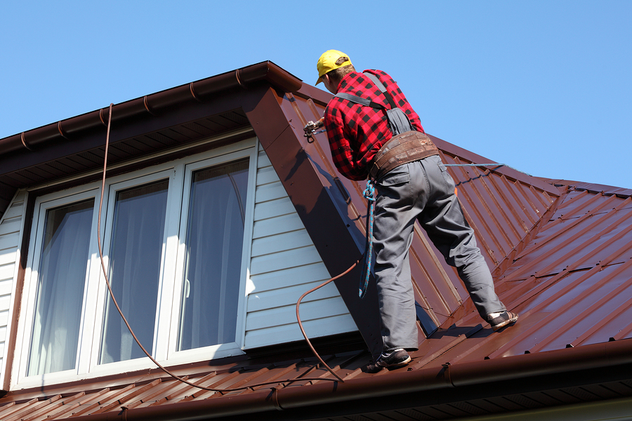 professional roofer doing residential roofing repair