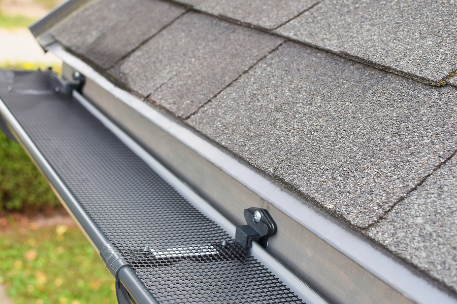 this image shows tracy roofing pros gutter installation