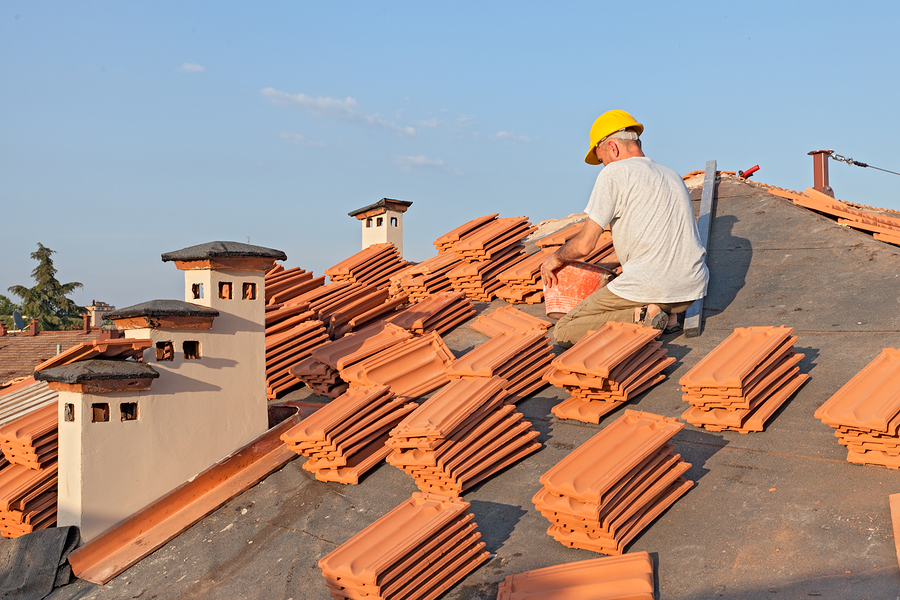 this is an image of roofers at work doing the mountain house roofing project