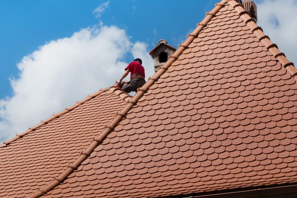 this picture shows clay tile roof by tracy roofing pros